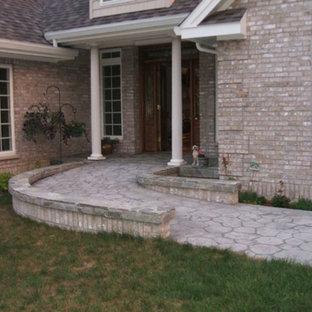 Idee per un ingresso o corridoio tradizionale con pavimento in cemento