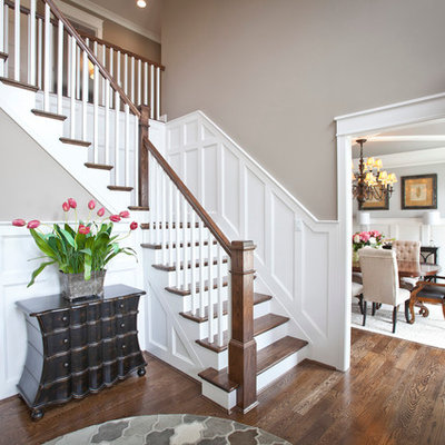 Example of a mid-sized transitional medium tone wood floor foyer design in Cincinnati with gray walls