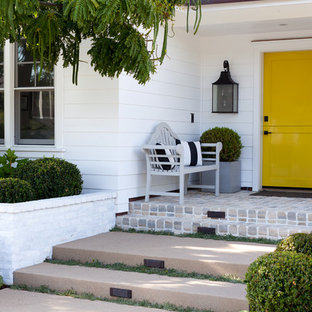 Elegant entryway photo in Orange County with a yellow front door