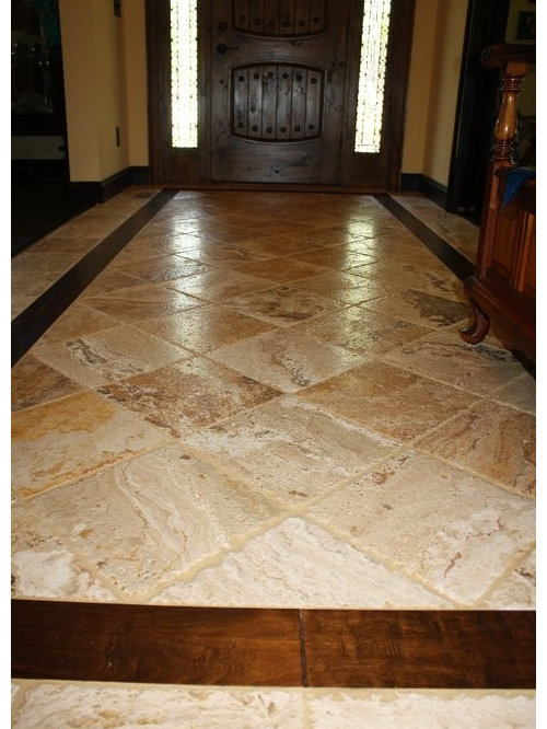 inspiration for a midsized timeless travertine floor and beige floor entryway remodel in atlanta