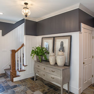 Entryway - mid-sized transitional porcelain floor and multicolored floor entryway idea in Boston with black walls and a white front door
