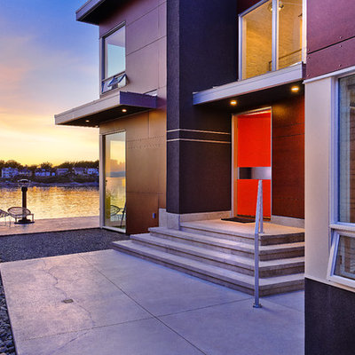 Inspiration for a contemporary single front door remodel in Vancouver with an orange front door