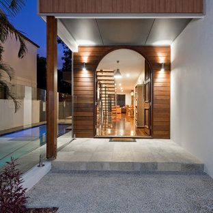 Design ideas for a contemporary front door in Brisbane with white walls, a single front door and a dark wood front door.