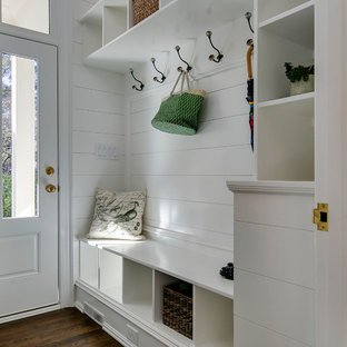Entryway - transitional medium tone wood floor and brown floor entryway idea in Raleigh with white walls and a glass front door