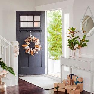 Mid-sized trendy dark wood floor single front door photo in Vancouver with white walls and a brown front door
