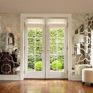 Brown floor entryway photo in New York with a white front door