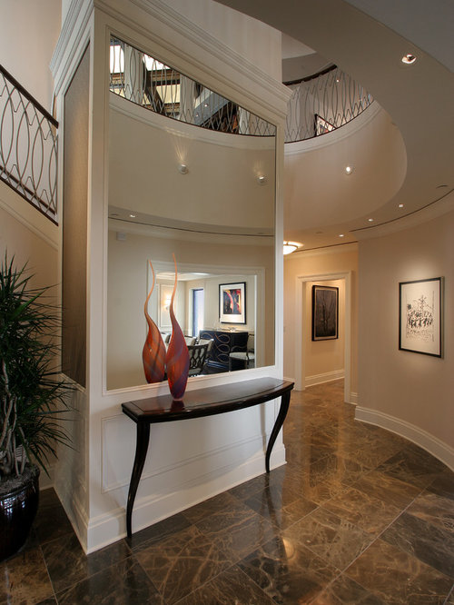 Foyer Designs Ideas foyer chair home design photos Example Of A Trendy Foyer Design In Milwaukee With Beige Walls