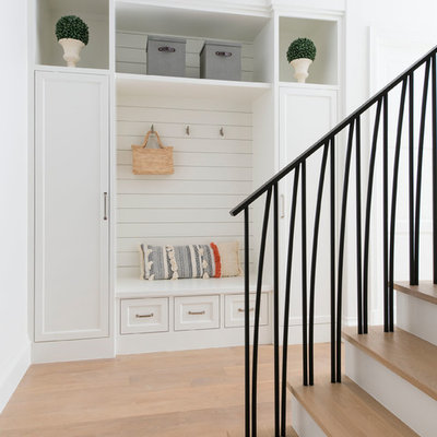 Inspiration for a mediterranean light wood floor and beige floor mudroom remodel in Dallas with white walls