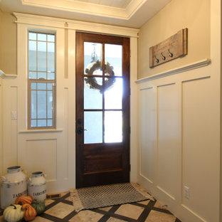 Imagen de distribuidor machihembrado y panelado, campestre, de tamaño medio, panelado, con paredes blancas, suelo de mármol, puerta simple, puerta de madera en tonos medios, suelo beige y panelado