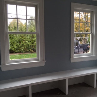 Mid-sized coastal porcelain floor and gray floor mudroom photo in New York with blue walls
