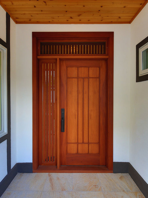 Inspiration for an asian porcelain floor entryway remodel in Hawaii with white walls and a medium & Japanese Doors | Houzz pezcame.com