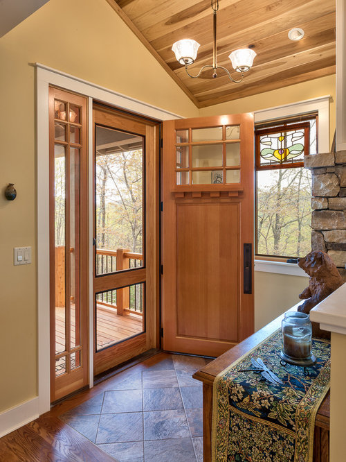 craftsman entryway idea in other with yellow walls