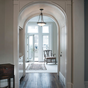 Inspiration for a classic foyer in DC Metro with grey walls, dark hardwood flooring, a single front door, a glass front door and brown floors.