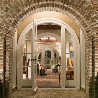 Example of a classic brick floor single front door design in Atlanta with a white front door