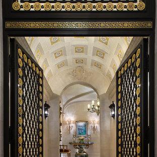 Huge elegant marble floor double front door photo in New York with beige walls and a metal front door