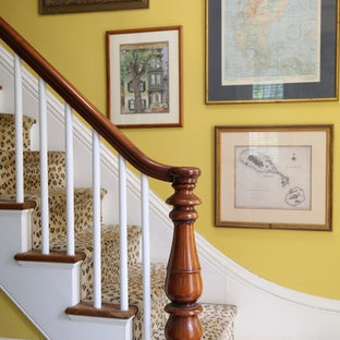 Mid-sized eclectic painted wood floor and black floor front door photo in Boston with yellow walls