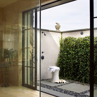 Example of a large country plywood floor and beige floor entryway design in San Francisco with beige walls and a glass front door