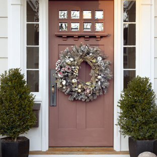Example of a classic entryway design in New York with a dark wood front door