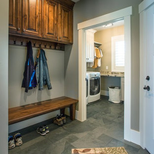 Mid-sized elegant gray floor and slate floor mudroom photo in Salt Lake City with a white front door and gray walls