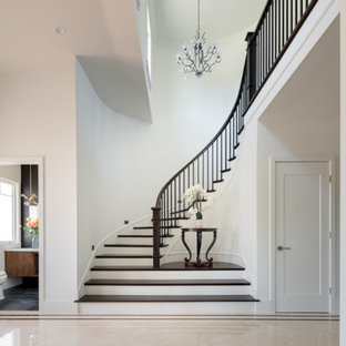 Mid-sized elegant ceramic floor entryway photo in Los Angeles with white walls and a glass front door