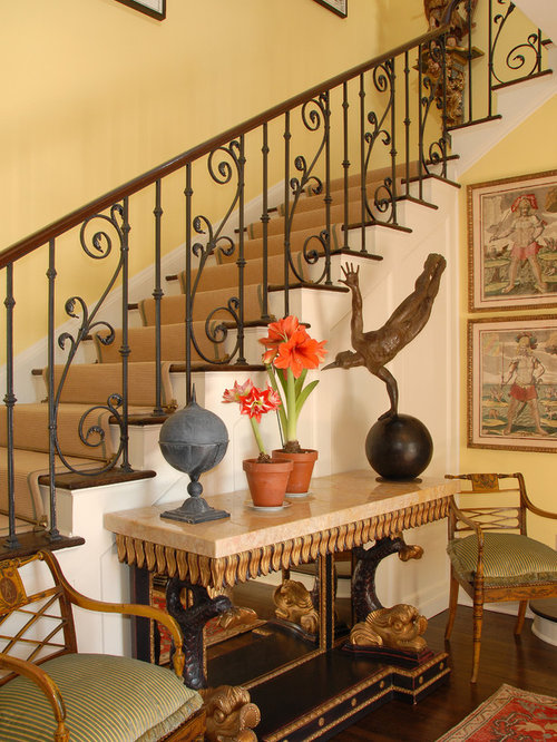 Example Of A Classic Foyer Design In Los Angeles With Yellow Walls
