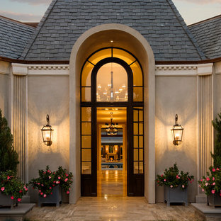 Inspiration for a timeless entryway remodel in Santa Barbara with a glass front door