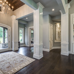 Inspiration for a large transitional dark wood floor and brown floor entryway remodel in Cincinnati with gray walls and a glass front door