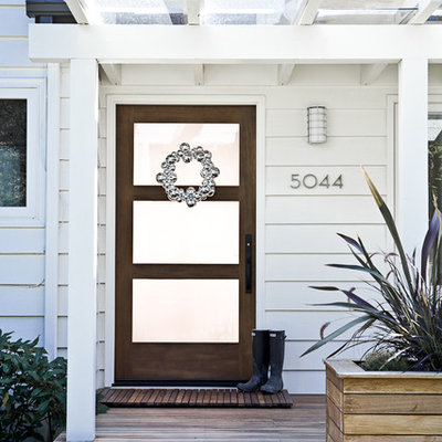 Inspiration for a timeless entryway remodel in Portland with a glass front door