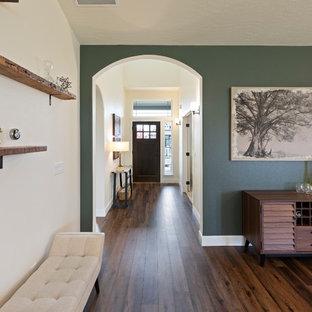Foto de puerta principal vintage, de tamaño medio, con paredes blancas, suelo vinílico, puerta simple, puerta de madera oscura y suelo marrón