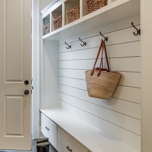 Farmhouse dark wood floor and brown floor entryway photo in Nashville with white walls and a white front door