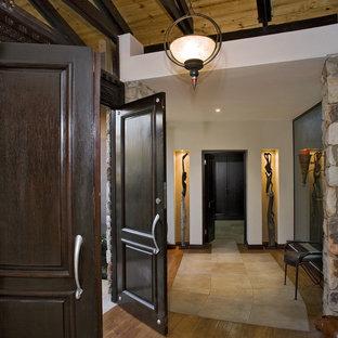 Example of a classic double front door design in Other with a dark wood front door