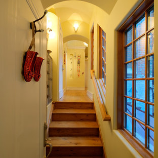 Example of a small eclectic medium tone wood floor entryway design in Chicago with yellow walls and a white front door