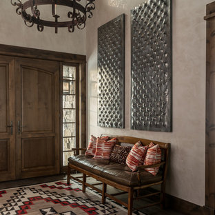 Photo of a mediterranean foyer in Other with beige walls, a double front door and a dark wood front door.