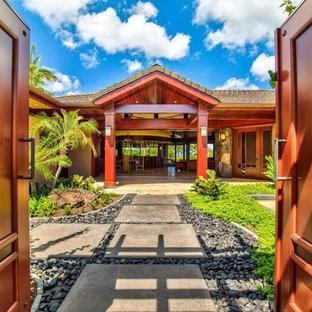Entryway - large craftsman marble floor entryway idea in Hawaii with beige walls and a medium wood front door