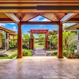 Inspiration for a large craftsman marble floor entryway remodel in Hawaii with beige walls and a medium wood front door