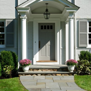 Inspiration for a timeless entryway remodel in New York with a gray front door
