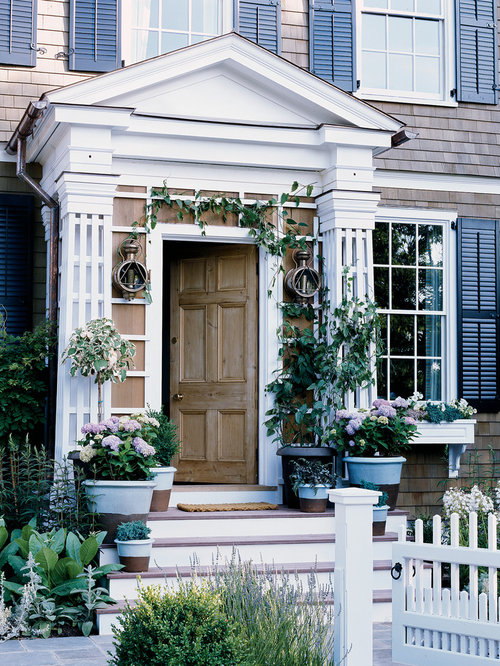 Entryway - traditional entryway idea in New York with a medium wood front door & Front Door Arbor | Houzz