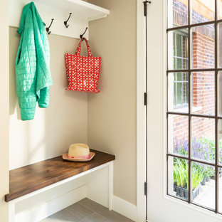 Inspiration for a large timeless porcelain tile and gray floor entryway remodel in Detroit with beige walls and a white front door