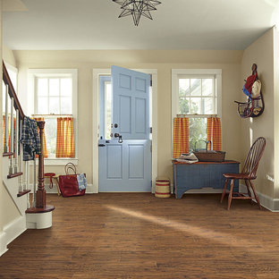 Mid-sized country dark wood floor entryway photo in Denver with beige walls and a blue front door