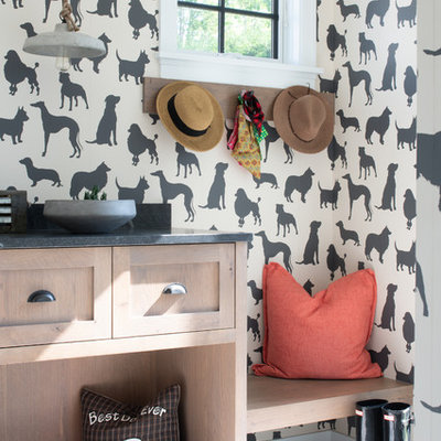 Mudroom - mid-sized transitional concrete floor and gray floor mudroom idea in Minneapolis with beige walls