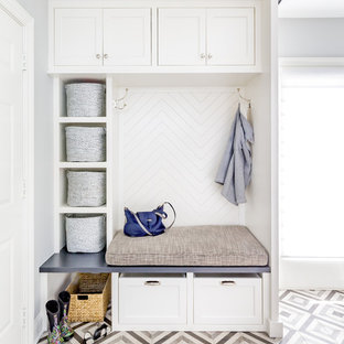 Inspiration for a mid-sized transitional porcelain floor and multicolored floor mudroom remodel in Chicago with gray walls