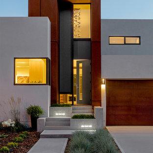 Entryway - modern concrete floor and gray floor entryway idea in Edmonton with beige walls and a gray front door