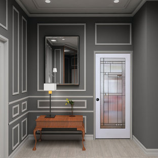 Example of a mid-sized classic light wood floor and beige floor entryway design in Vancouver with a glass front door and gray walls