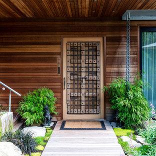 Entryway - asian light wood floor entryway idea in Vancouver with a light wood front door
