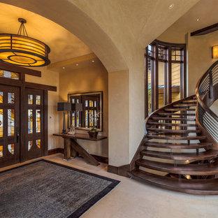 Entryway - contemporary beige floor entryway idea in Salt Lake City with a dark wood front door