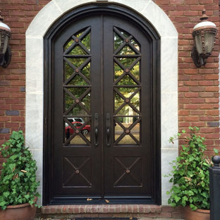 Example of a large transitional entryway design in Atlanta with a metal front door