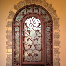 Traditional Entry by Colletti Design Iron Doors