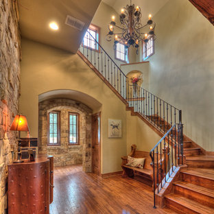 Large mountain style medium tone wood floor foyer photo in Austin with beige walls