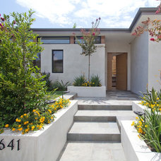 Contemporary Entry by Building Solutions and Design, Inc
