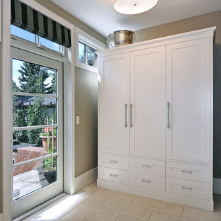 Entryway - transitional entryway idea in Calgary with beige walls and a glass front door